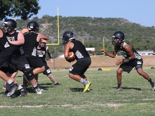 Junction High School football players participate in a practice session in August 2016.