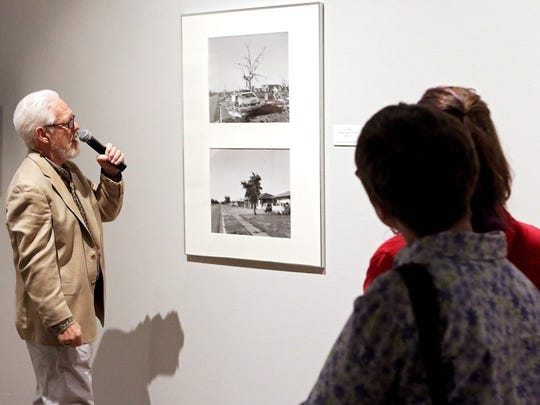 """Patrick Johnston/Times Record News Frank Gohlke talks about a picture set titled """"4503 McNeil"""" during a reception for the opening of the """"Aftermath: The Wichita Falls Tornado"""" exhibit Thursday evening at the Wichita Falls Museum of Arts."""