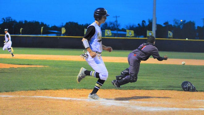 Clyde's Austyn Deal crosses home plate as Stanton catcher Thomas Zarate dives for a wild throw in the third inning of Tuesday's lightning-halted game in Clyde.