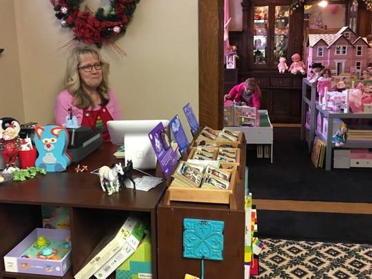 Shoppers explore Washington Street Toy Emporium near downtown Muncie during Small Business Saturday Nov. 26.