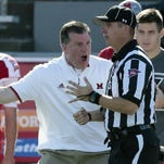 Miami head coach Chuck Martin argues for a penalty flag in the second quarter.