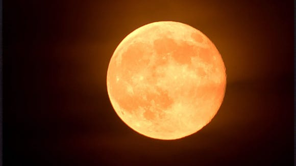 "The ""Super Moon"" rises into clouds over the Shenandoah Valley on Saturday, July 12, 2014"