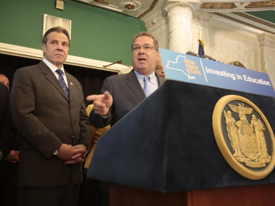Yonkers Mayor Michael Spano and Gov. Andrew Cuomo spoke June 14, 2015, during a news conference. Cuomo announced a proposed $100 million education fund, part of which he said would help the struggling Yonkers school district.