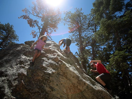 Jessica March 13, hangs on a boulder at Mt. San Jacinto State Park on Wednesday.