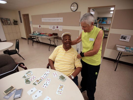 Beverly Greer the CEO of Neuro Vitality Center in Palm Springs chats with stroke patient Norman Brown, 80, of Palm Springs on Friday. The center helps people recover from strokes.