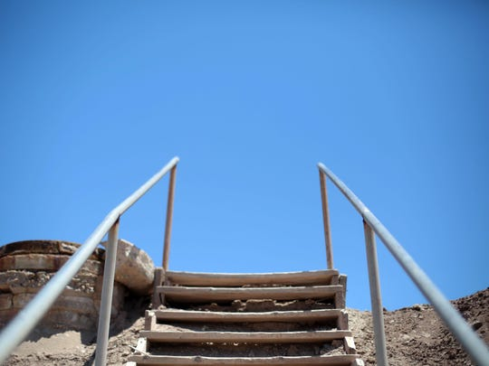 Stairs rise over the dike that separates the community of Bombay Beach from the Salton Sea on July 28, 2015.