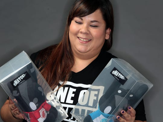 Aide Ayala with avatar dolls that represents members of her favorite K-Pop band members of B.A.P. on Friday at the Desert Sun Studio.