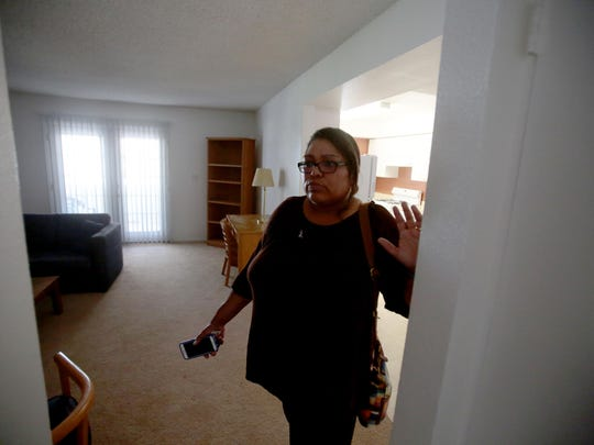 Angelina Coe, the executive director for Shelter from the Storm, shows an apartment unit to house a family of domestic abuse at the Florence Rigdon Transitional Living Center on Tuesday. The shelter lost $150,000 in HUD funding and may have to cut staff and services.