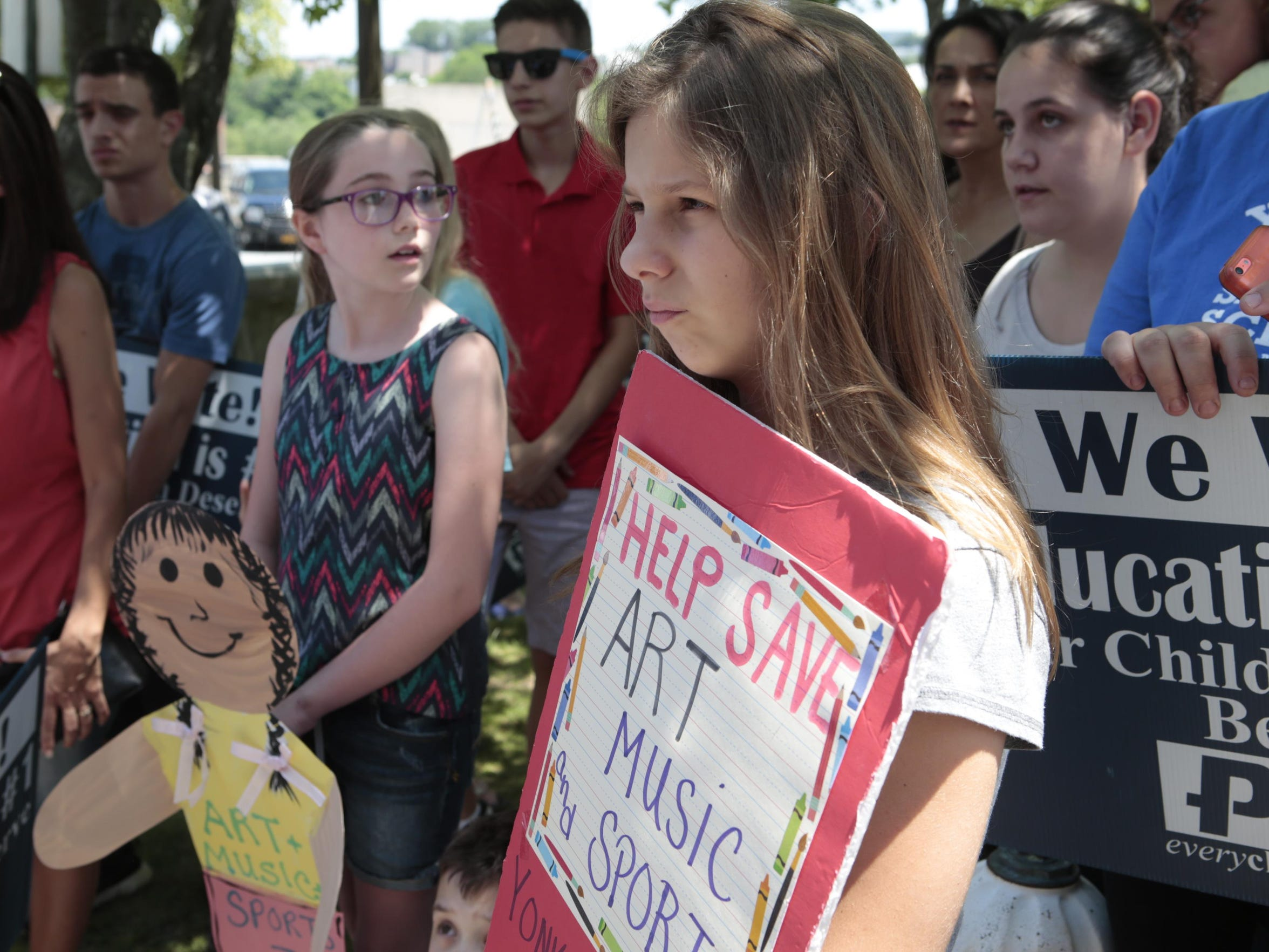 Emily Djonbalaj, of Yonkers, joined demonstrators who