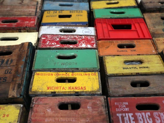 Colorful old boxes in the studio of contemporary realist artist Robert Jackson.