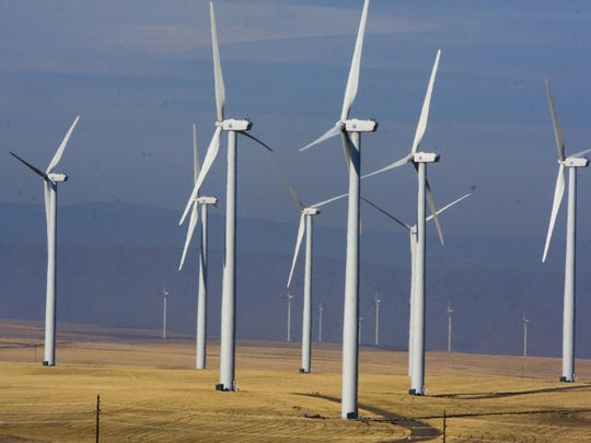 Wind turbines dot the landscape east of Wasco, Oregon. California, Hawaii, Oregon, New York and many other Democratic-leaning states have ambitious goals to wean themselves off fossil fuels, but doing so requires an investment in renewable energy that could be in jeopardy now that Donald Trump is president.