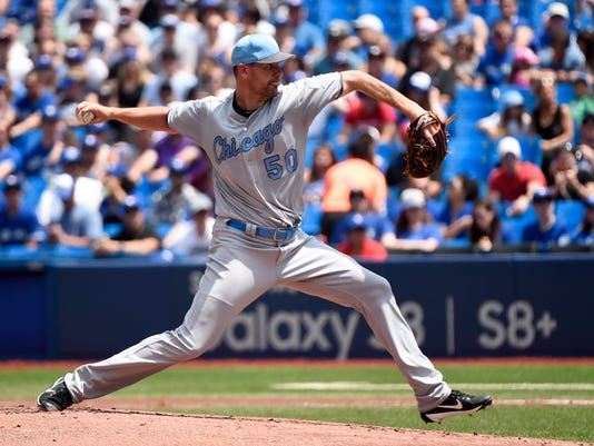 Chicago White Sox starting pitcher Mike Pelfrey (50) delivers a pitch to home against the Toronto Blue Jays during first inning  of a baseball game in Toronto on Saturday, June 17, 2017. (Nathan Denette/The Canadian Press via AP)