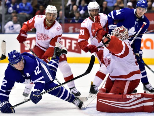 Detroit Red Wings goaltender Jimmy Howard (35) makes a save on Toronto Maple Leafs center Patrick Marleau (12) during the second period of an NHL hockey game Saturday, March 24, 2018, in Toronto. (Frank Gunn/The Canadian Press via AP)