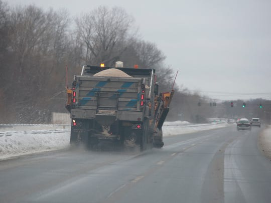 A Yorktown public works truck salts and clears Route 6 in Shrub Oak on Monday.