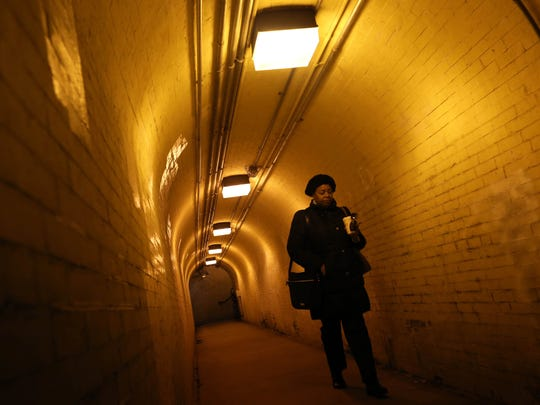 Johnnie Morrison of New Castle walks through the pedestrian tunnel underneath the tracks to a northbound SEPTA train at Claymont train stop early Friday morning.