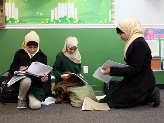 Sixth-graders (from left) Hannan Qasim, 13; Neessam Moustafa, 11; and Maria Nagi, 12, study at Tarbiyah School of Delaware in Newark on Friday. Delaware's Muslim population has been steadily increasing. Today, the Masjid Ibrahim at the Islamic Society of Delaware in Newark must hold two Friday prayer services to handle visitors.