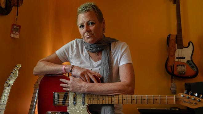 Singer, songwriter, guitarist and record producer Anita Cochran poses for a portrait at her home in Franklin, Tenn., Tuesday, June 19, 2018. Cochran, who has been undergoing breast cancer treatment since last fall has written a new single, Fight Like A Girl.