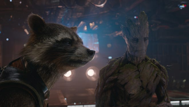 Meet the summer's hottest duo: Rocket Raccoon (voiced by Bradley Cooper) and Groot (voiced by Vin Diesel)  from 'Guardians of the Galaxy.'