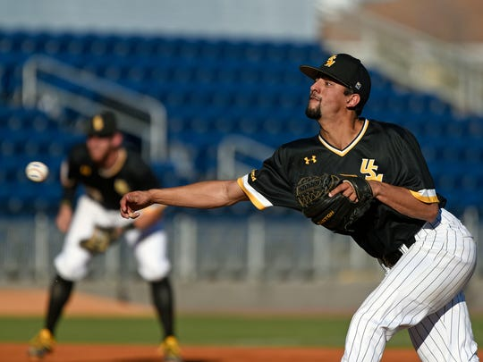 Southern Mississippi's Nick Sandlin pitches to Ohio State's Dominic Canzone Saturday, March 3, 2018 during the Cox Diamond Invitational at Blue Wahoos Stadium.