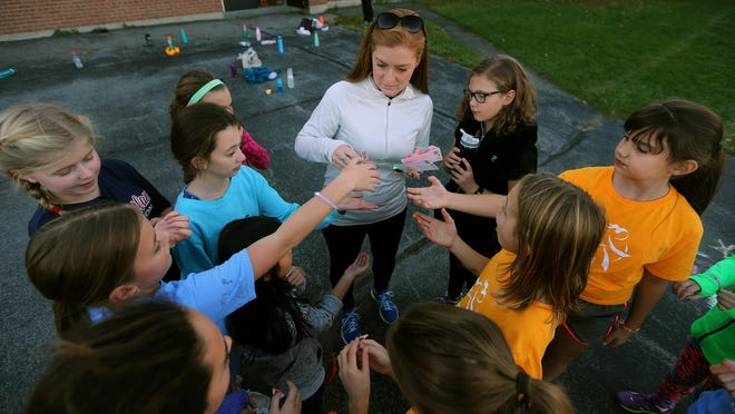 Randi Proukou volunteers with the Girls on the Run program that meets at Park Road School in Pittsford.