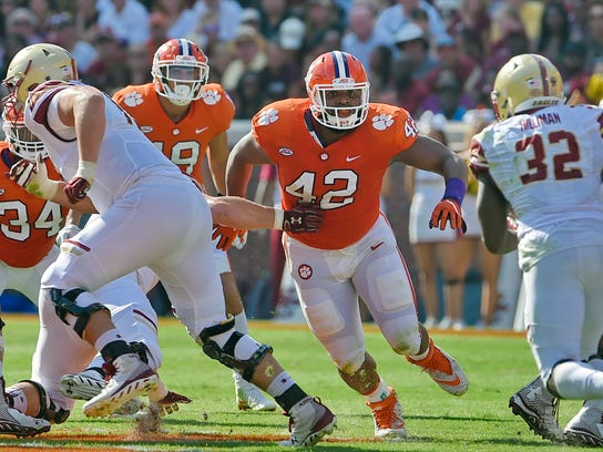 FILE - In this Sept. 23, 2017, file photo, Clemson's Christian Wilkins defends during the first half of an NCAA college football game against Boston College, in Clemson, S.C. Wilkins was selected to the AP All-America team announced Monday, Dec. 11, 2017.  (AP Photo/Richard Shiro, File)