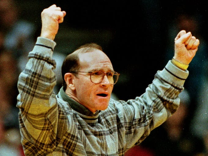 Dan Gable celebrates during a dual meet on Feb. 18, 1996 in Iowa City.