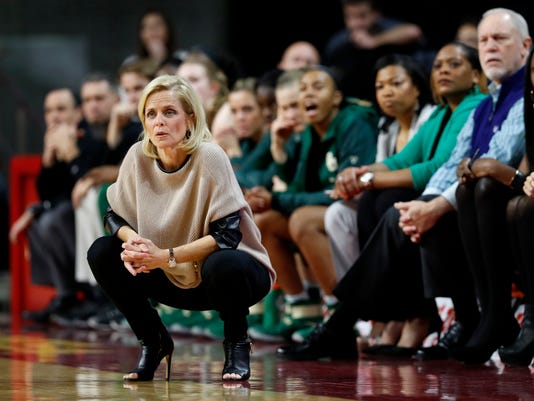Baylor coach Kim Mulkey watches from the bench during the first half of the team's NCAA college basketball game against Iowa State, Wednesday, Feb. 1, 2017, in Ames, Iowa. (AP Photo/Charlie Neibergall)