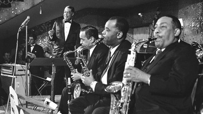 Band leader Duke Ellington and his big band during his appearance on the stage at -Bal Pare-, a top social event in this Bavarian capital in Munich, Jan. 21, 1967 during the carnival season. Ellington received enthusiastic applause while on the stages. The band presently tours Germany in company of singer Ella Fitzgerald.