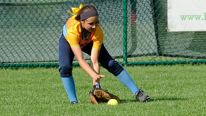 River Valley outfielder Kylie Lang fields a hard ground ball during Monday night's district final game against Lakewood. The Vikings fell 8-2.