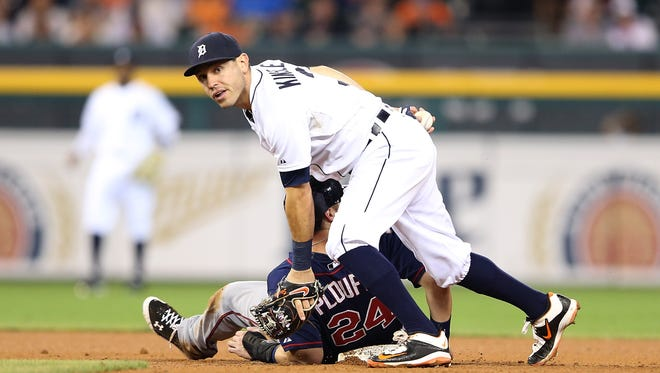 Twins third baseman Trevor Plouffe and Tigers second baseman Ian Kinsler get tangled up in the double play attempt during the fifth inning of the Tigers' win Friday at Comerica Park.