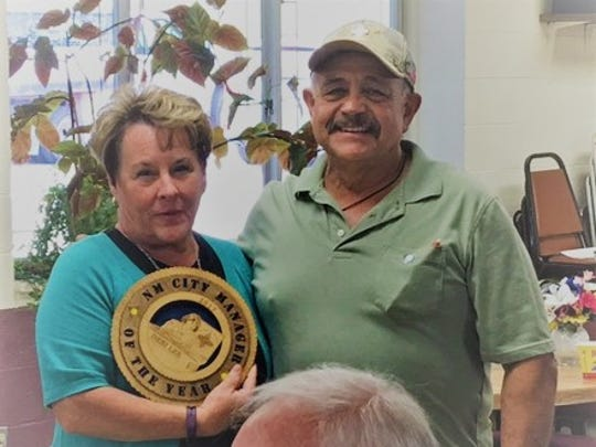 Debbie Lee, city manager of the year award recipient, and Eddie Saenz attend the annual Ruidoso city employee picnic Thursday.