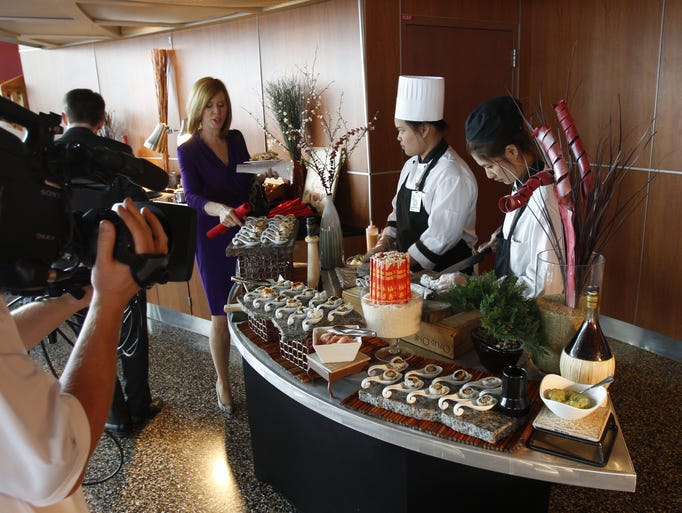 Hand-rolled sushi is prepared for members of the media during an event to showcase the new food offerings this year at Great American Ball Park.