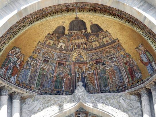 Gilded mosaic tiles adorn the facade of the basilica