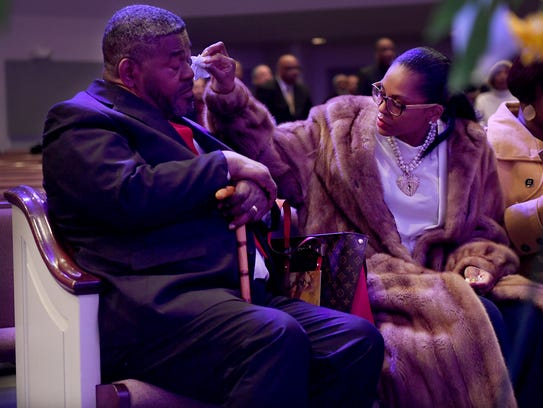 Dawn Jones wipes away tears from the eyes of her father,