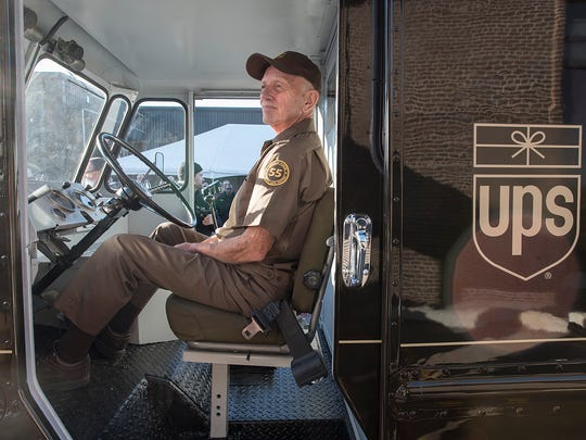 Tom Camp, sitting at the wheel of the restored 1964 delivery van, might be thinking about his 55 years of driving for UPS.
