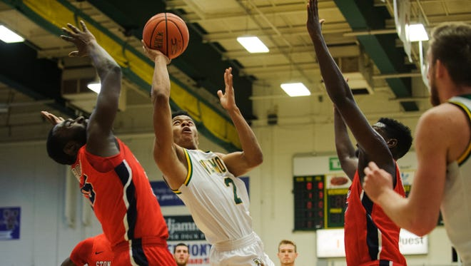 Vermont's Tare Bell-Haynes (2) leaps for a lay up during the men's basketball game between the Stony Brook Seawolves and the Vermont Catamounts at Patrick Gym on Saturday afternoon January 13, 2018 in Burlington.