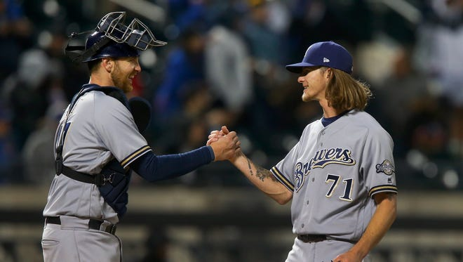 Reliever Josh Hader (right) and Jett Bandy celebrate after beating the Mets, 5-1.