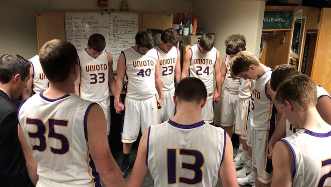 Before each game, Unioto coach Matt Hoops leads a team prayer asking for safety, strength and continued health.