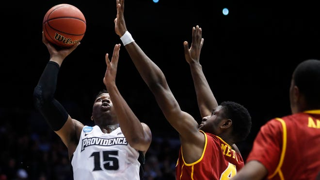 Providence's Emmitt Holt shoots against Southern California's Chimezie Metu (4) during the first half Wednesday, March 15, 2017, in Dayton, Ohio. Holt was the top scorer for the Friars, but Providence went cold in the second half.