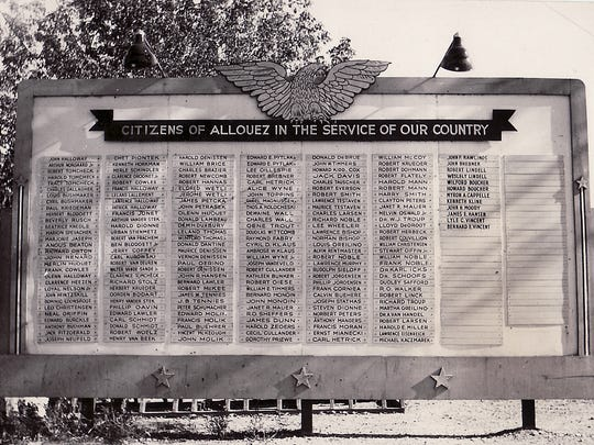 A black-and-white photo of the original billboard that honored almost 200 men and women from Allouez who were thought to have been serving the United States armed forces during World War II in the 1940s. Where the billboard was located and what happened to it remains a mystery for those veterans and family members who are still living.
