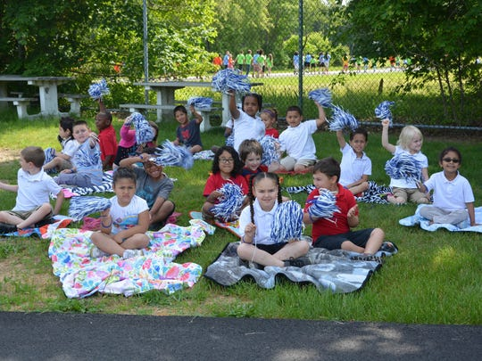 Kindergarten and first-grade students watch the 38th