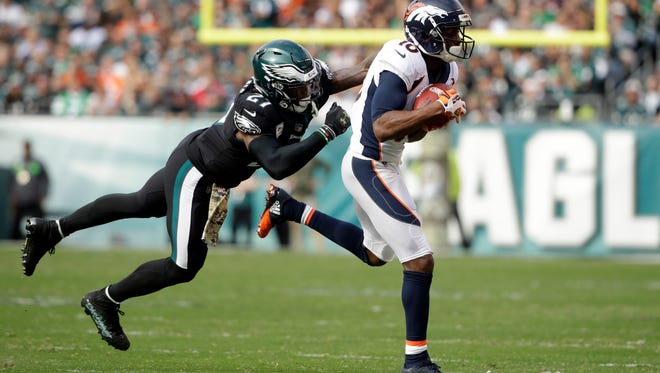 Denver Broncos' Bennie Fowler, right, is tackled by Philadelphia Eagles' Malcolm Jenkins (27) during the first half of an NFL football game, Sunday, Nov. 5, 2017, in Philadelphia.