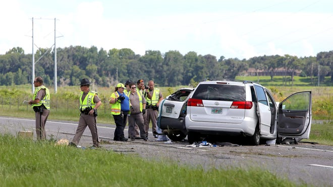 Florida Highway Patrol troopers investigate a two-vehicle accident that killed two people near the boardwalk on U.S. 441 on the stretch that runs through Paynes Prairie, just south of Gainesville Monday afternoon. The FHP believes a vehicle traveling northbound crossed the median and hit a second vehicle that was headed southbound, killing two peoplein the northbound vehicle and sending one driver from the southbound vehicle to the hospital.