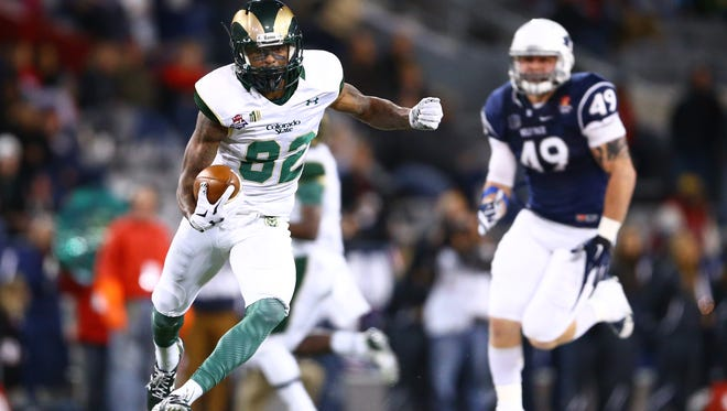 CSU receiver Rashard Higgins runs away from Nevada defenders during the Dec. 29 Arizona Bowl in Tucson. Higgins, a fifth-round selection, was one of six draft picks to sign Friday with the Cleveland Browns.
