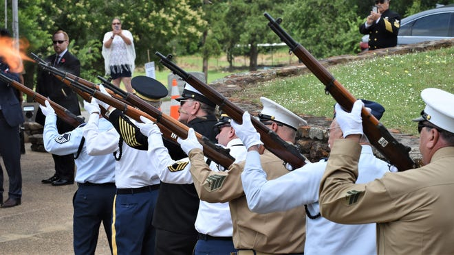 The Bastrop County Veterans Honor Guard fires the 21-gun salute at the 18th annual Memorial Day Ceremony at Bastrop's Fairview Cemetery in 2019.