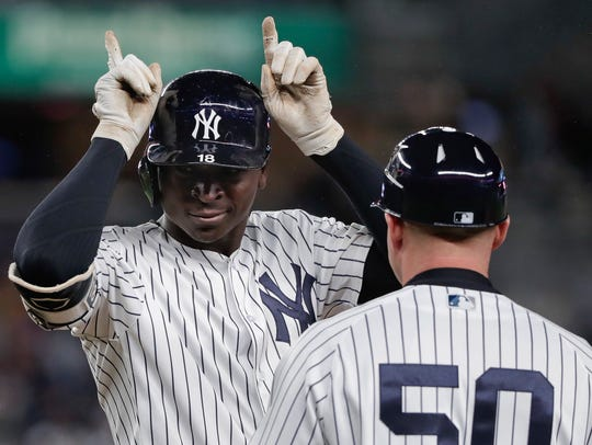 New York Yankees' Didi Gregorius motions to the dugout