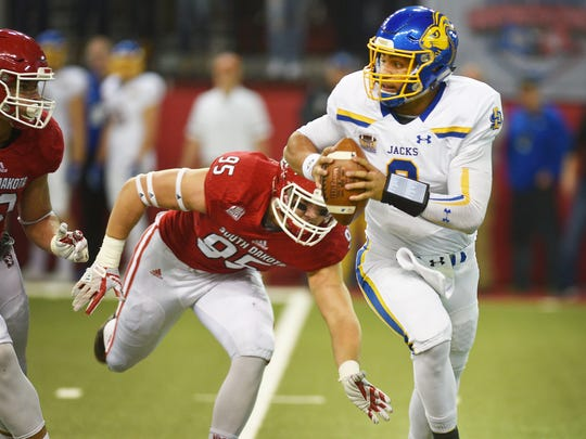 SDSU's Taryn Christion runs past USD's Nick Kramer
