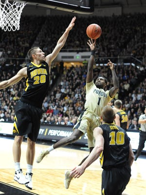 Purdue guard Johnny Hill drives to the basket amid heavy defense from Iowa on Saturday evening in Mackey Arena.