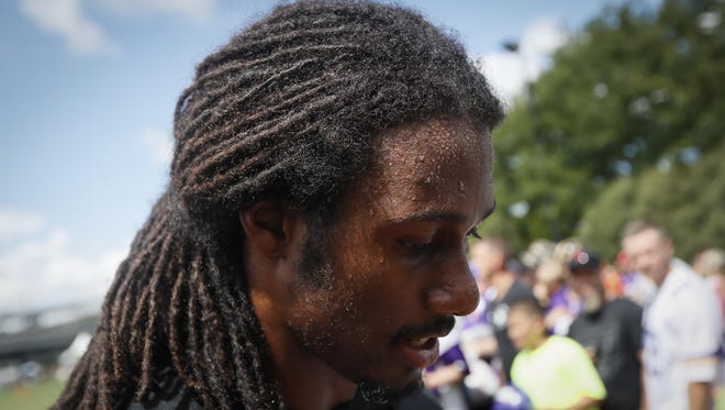 Beads of sweat gather on the forehead of Minnesota Vikings cornerback Trae Waynes following a joint practice Thursday with the Cincinnati Bengals in Cincinnati.