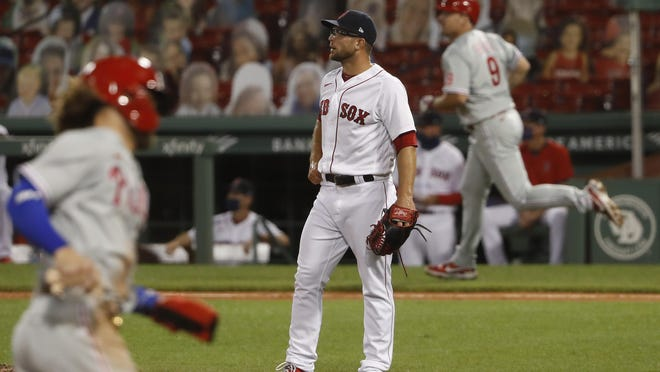 Marcus Walden watches a three-run homer by Jay Bruce carry out of Fenway Park on Tuesday night.